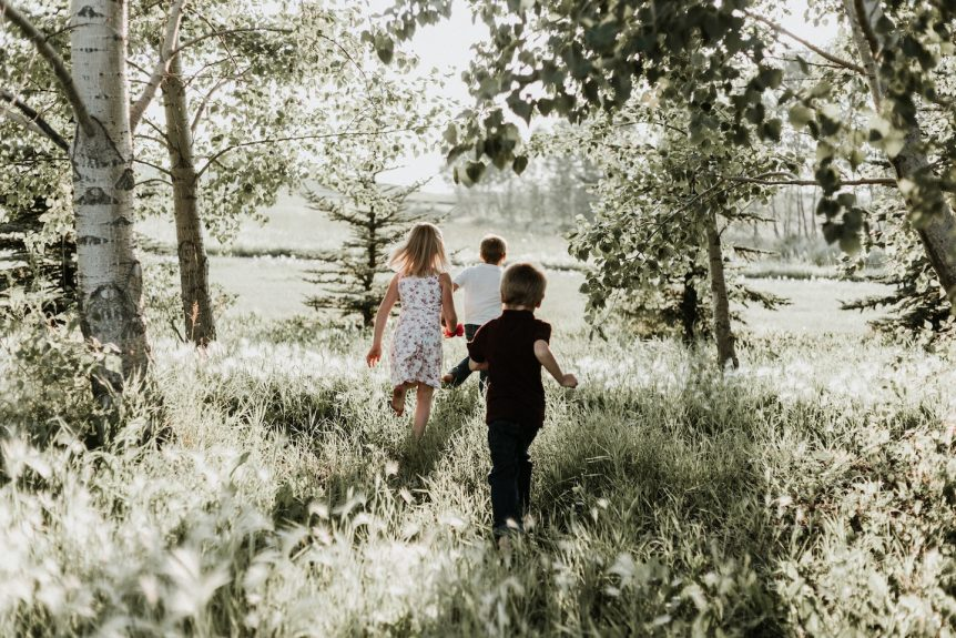 modern mystery school children running through field